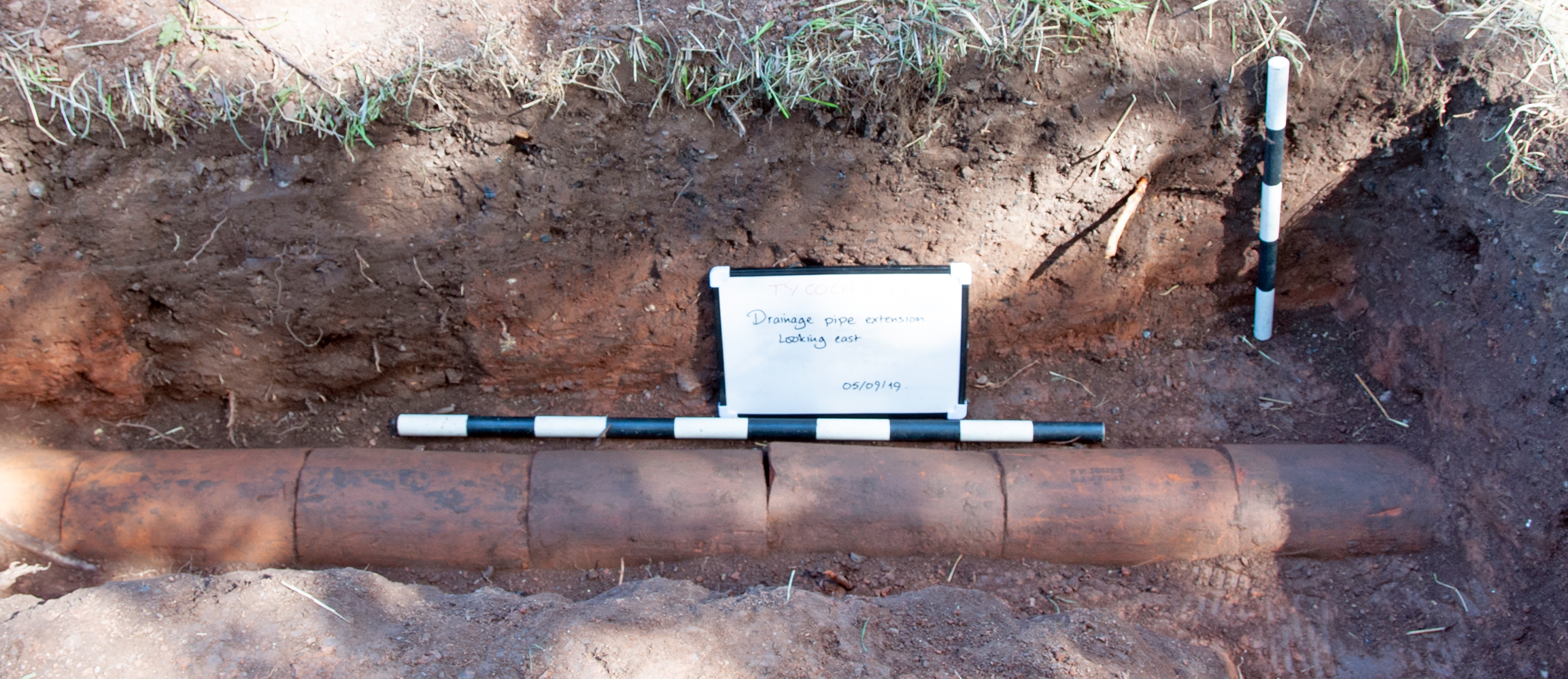 A length of terracotta drain pipe