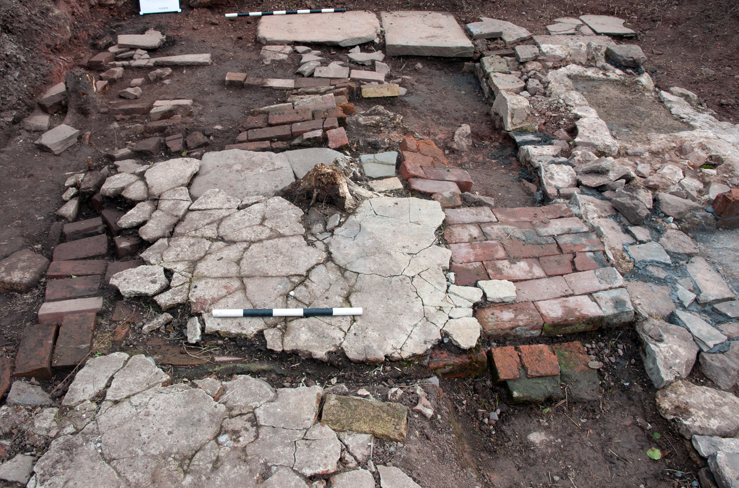 The damaged brick and cement surface to the east of the cottage