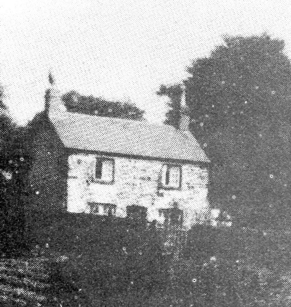 Fuzzy photograph of Ty Coch lock-keepers cottage